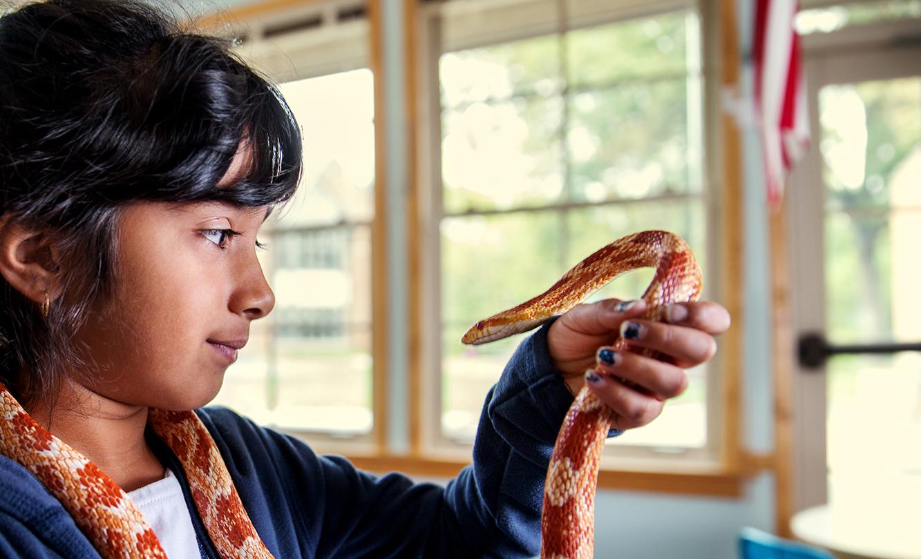 Community School Student Holding Pet Snake