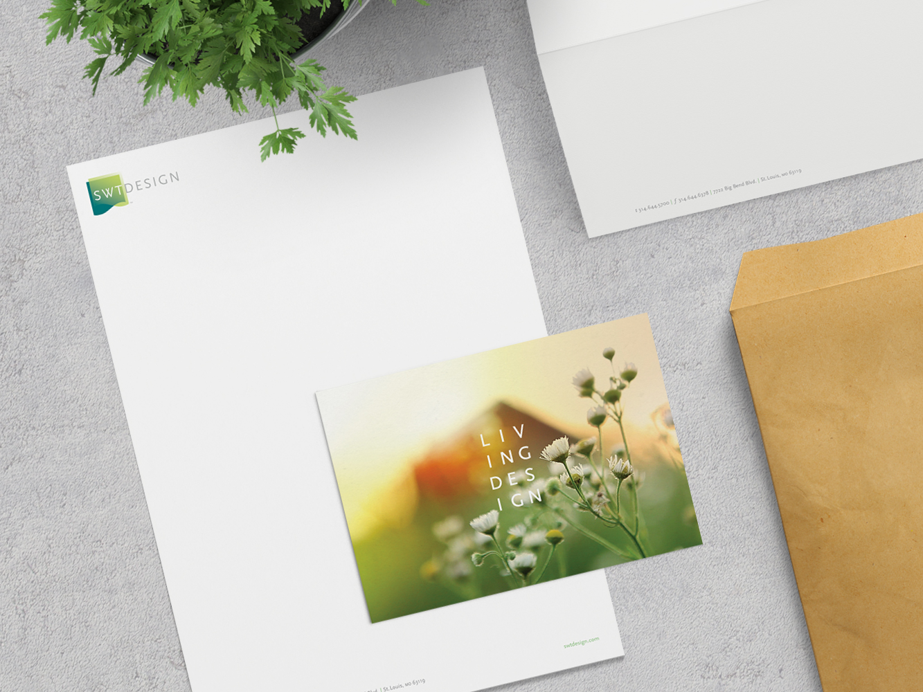 Image of SWT Design's stationary and postcard on a desktop