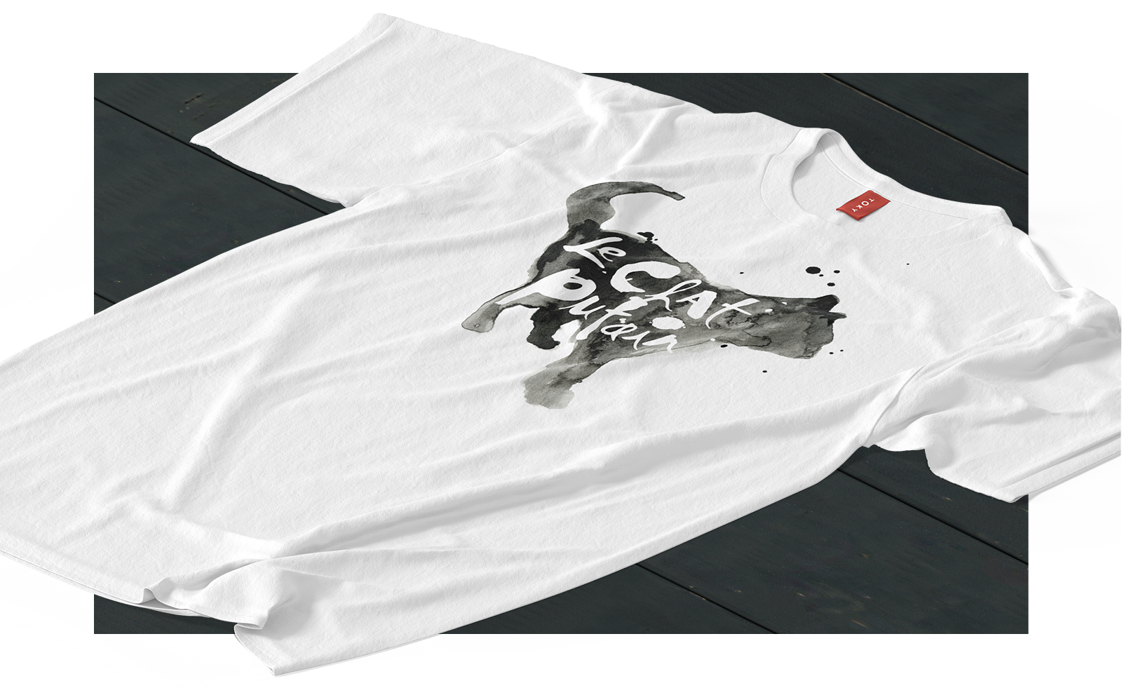 Le Chat Putain t-shirt front, laying on table