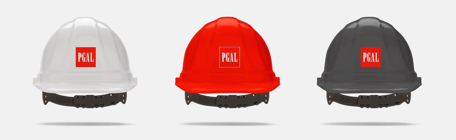 Three hard hats with PGAL logo