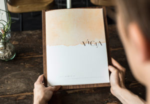 Diner holding Vicia menu