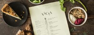 Aerial shot of Vicia menu and food