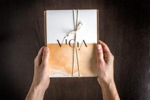 Hands holding Vicia menu
