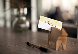 Vicia business card in wooden stand