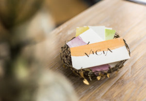 Vicia business cards in basket