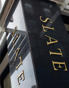 Photo of Slate signage on pole