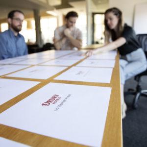 Drury Hotels creative team selecting taglines