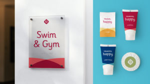 "Drury Hotels branded ""swim & gym"" signage and travel soaps"