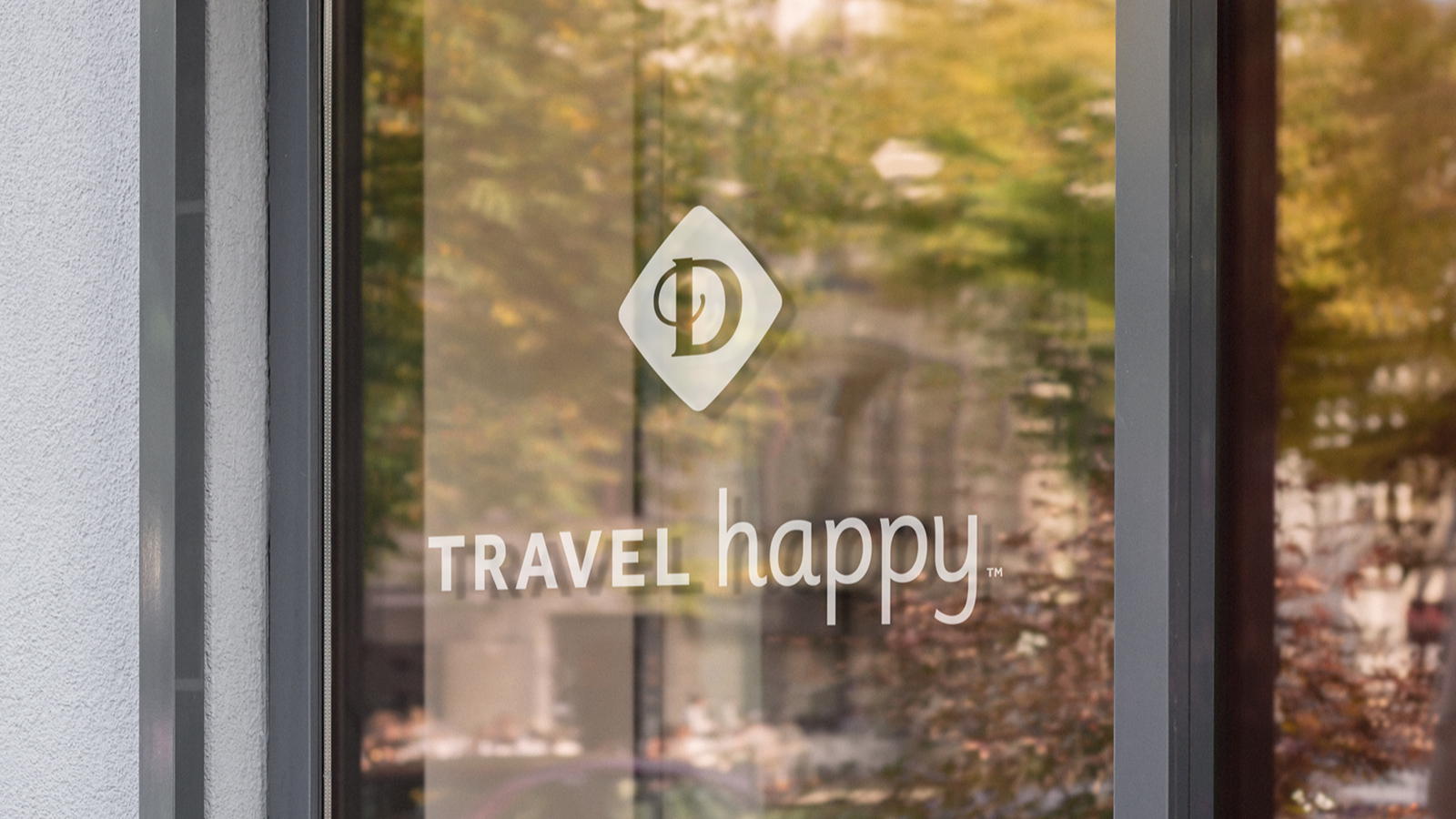 "Drury Hotels vinyl sign - ""Travel Happy"" tagline"