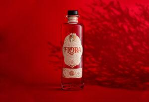 Flora bottle, red background, shadow