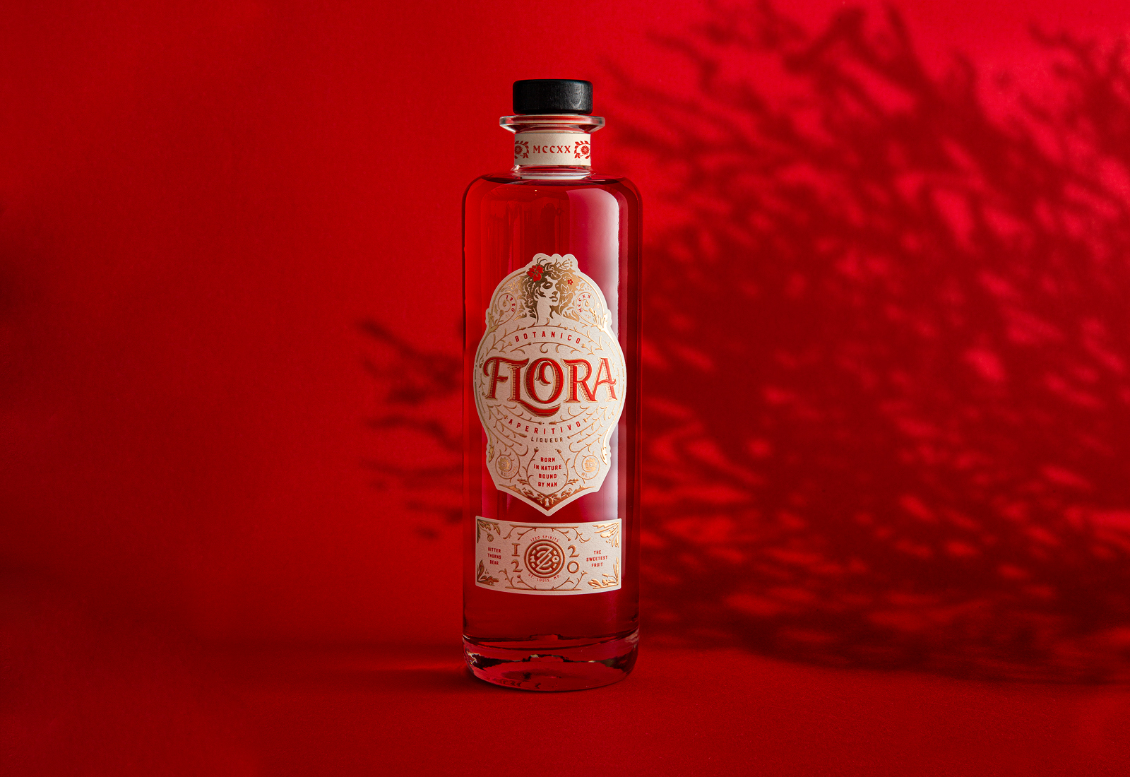 Flora bottle, red background, shadow