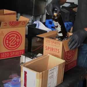 Packaging Spettro bottles at 1220 Spirits