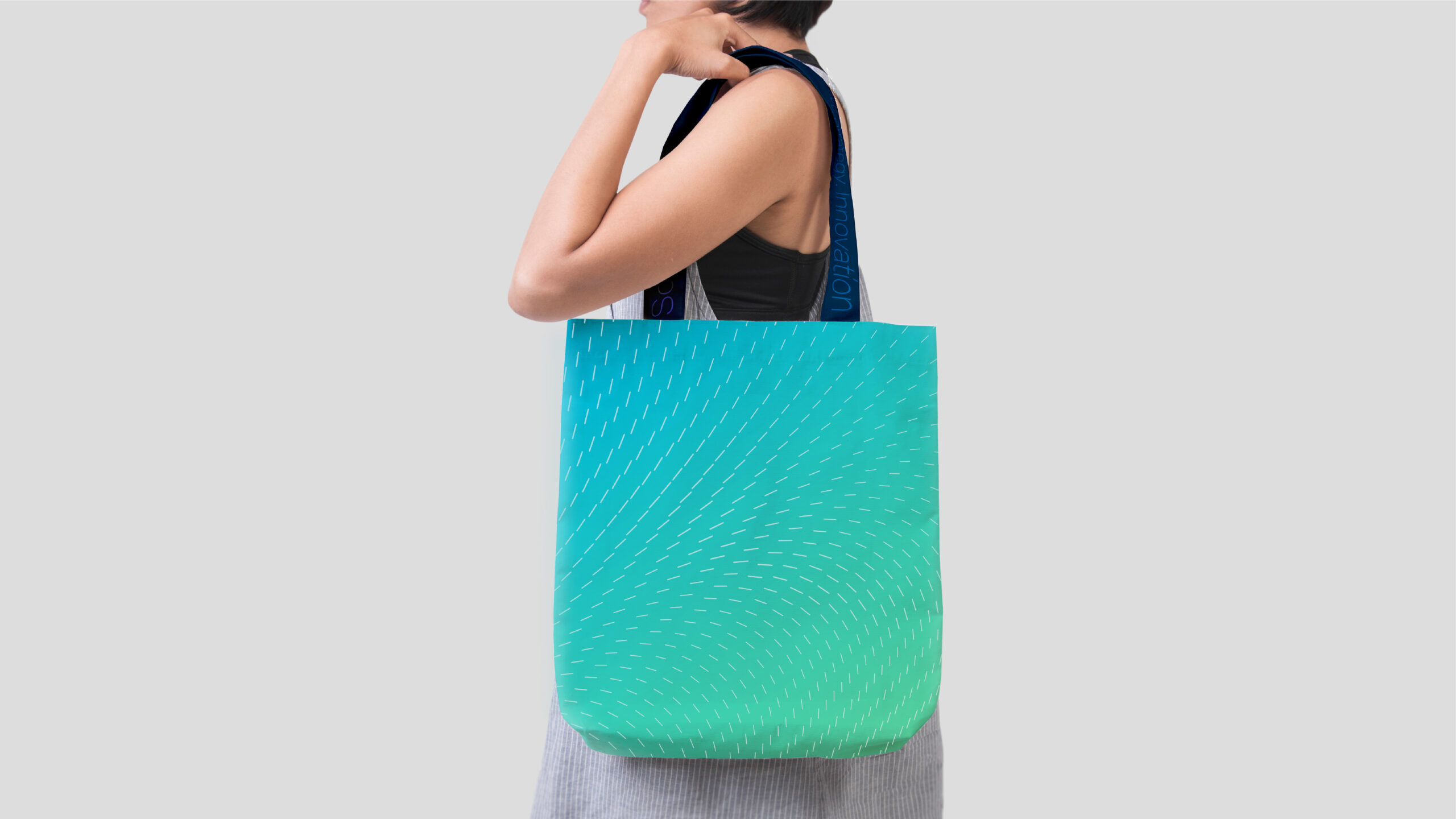 Woman with RiverVest branded tote bag