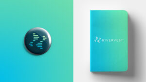 RiverVest branded pin and notebook