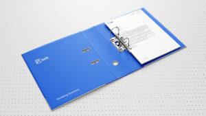 KEB branded binder on dot pattern background