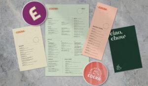 Edera menu and coasters on marble