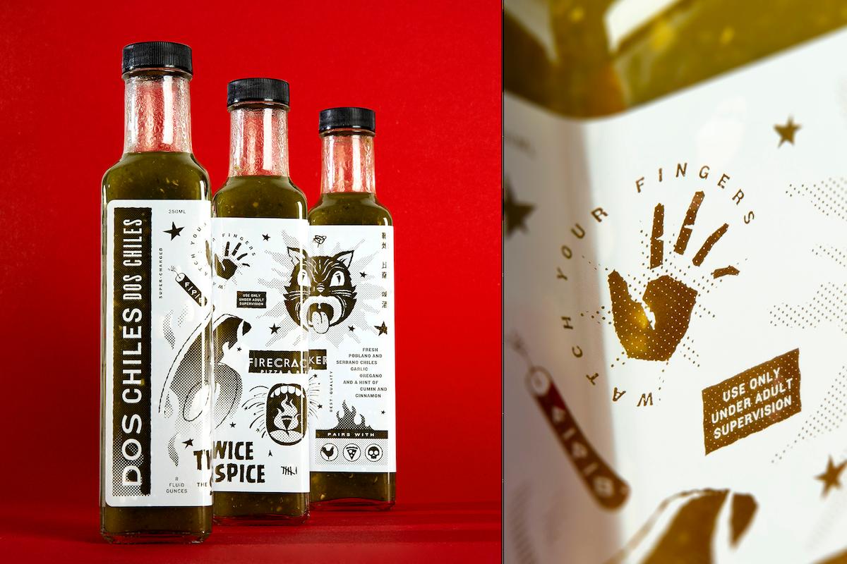 Photo of Firecracker's green hot sauce bottles