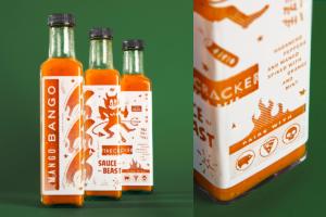 Photograph of Firecracker's orange hot sauce bottles